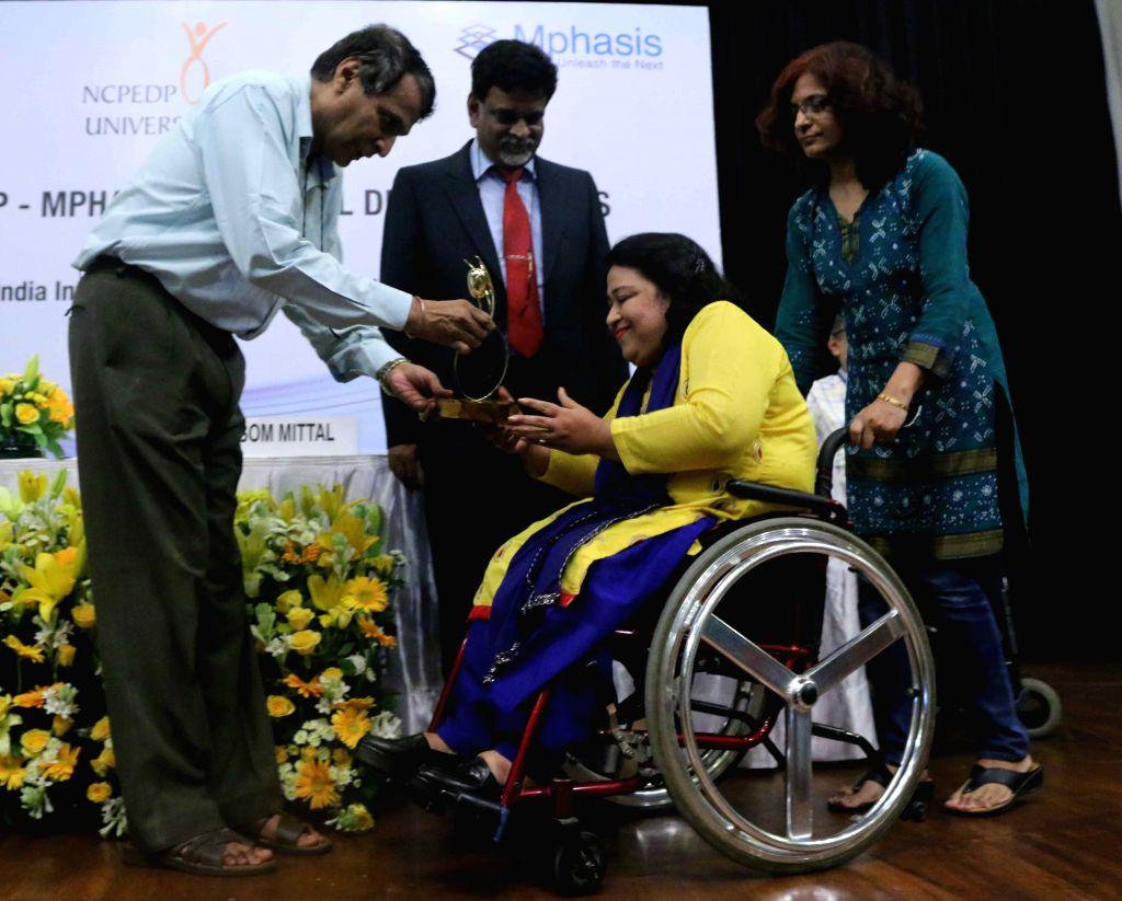 Union Railways Minister Suresh Prabhakar Prabhu during the 6th NCPEDP-MPHASIS Universal Design Awards in New Delhi on Aug 14, 2015. - Suresh Prabhakar Prabhu