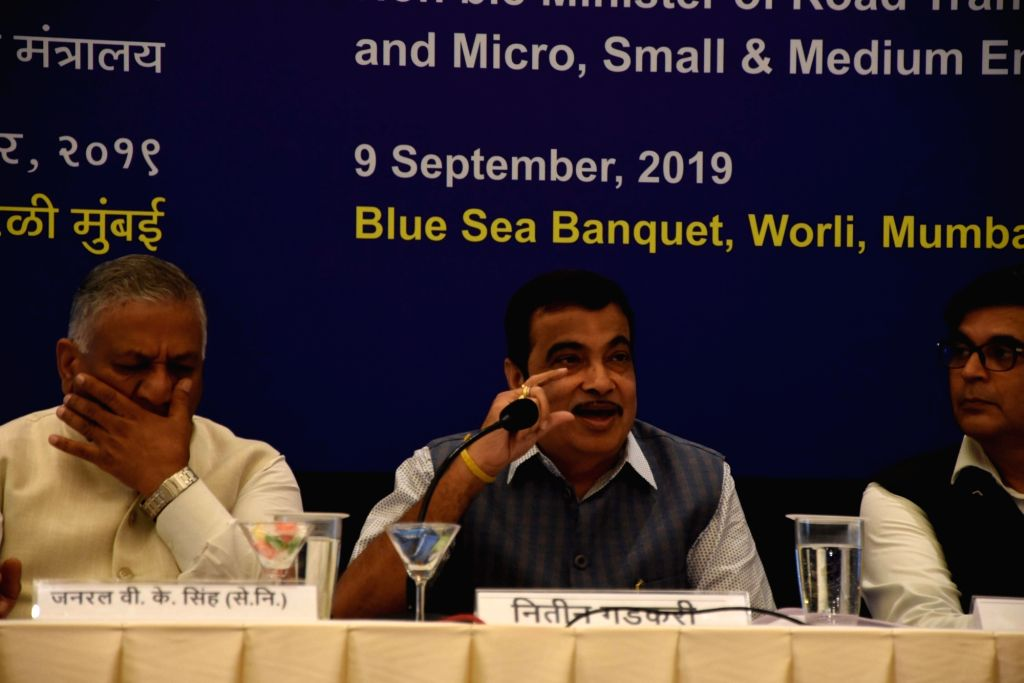 Union Road Transport and Highways Minister Nitin Gadkari accompanied by Union MoS Road Transport and Highways V.K. Singh addresses a press conference on '100 days of bold initiatives and ... - Nitin Gadkari and K. Singh