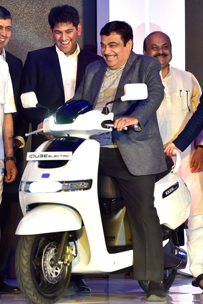 Union Road Transport and Highways Minister Nitin Gadkari and Karnataka Home Minister Basavaraj Bommai at the launch of the TVS iQube electric scooter, in Bengaluru on Jan 25, 2020. - Nitin Gadkari