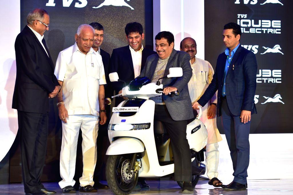 Union Road Transport and Highways Minister Nitin Gadkari, Karnataka Chief Minister BS Yediyurappa, state Home Minister Basavaraj Bommai and TVS Group Chairman Venu Srinivasan at the launch ... - Nitin Gadkari