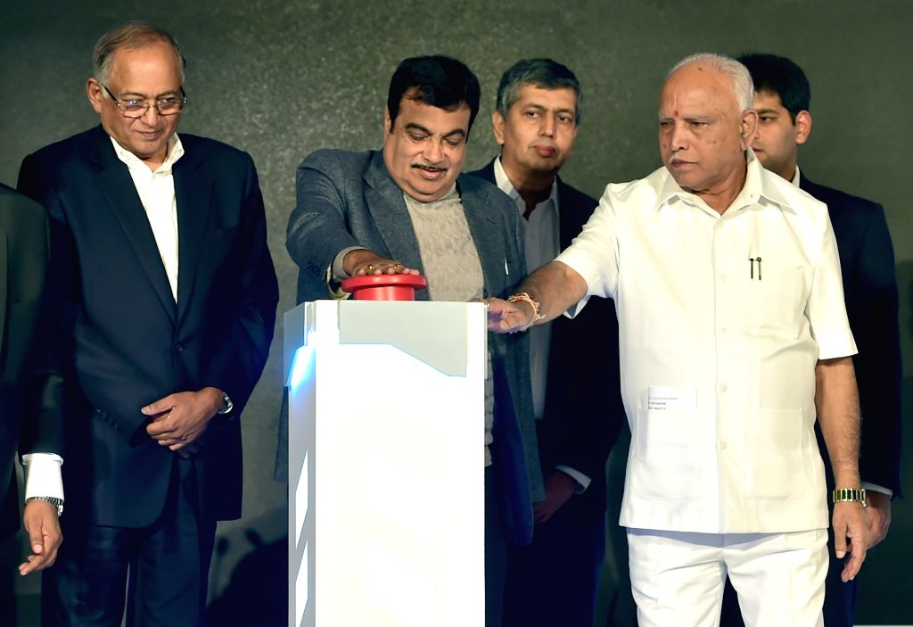 Union Road Transport and Highways Minister Nitin Gadkari, Karnataka Chief Minister BS Yediyurappa and TVS Group Chairman Venu Srinivasan at the launch of the TVS iQube electric scooter, in ... - Nitin Gadkari