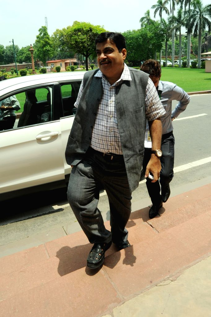 Union Road Transport, Highways and Shipping minister Nitin Gadkari arrives at the Parliament in New Delhi on July 30, 2014. - Nitin Gadkari