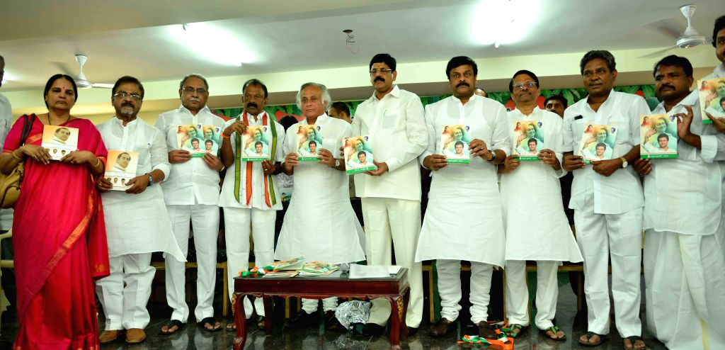 Union Rural Development Minister Jairam Ramesh with Raghuveera Reddy, Ramnarayan Reddy and Chiranjeevi during release of Congress manifesto at Indira Bhavan in Hyderabad on April 18, 2014. - Raghuveera Reddy and Ramnarayan Reddy