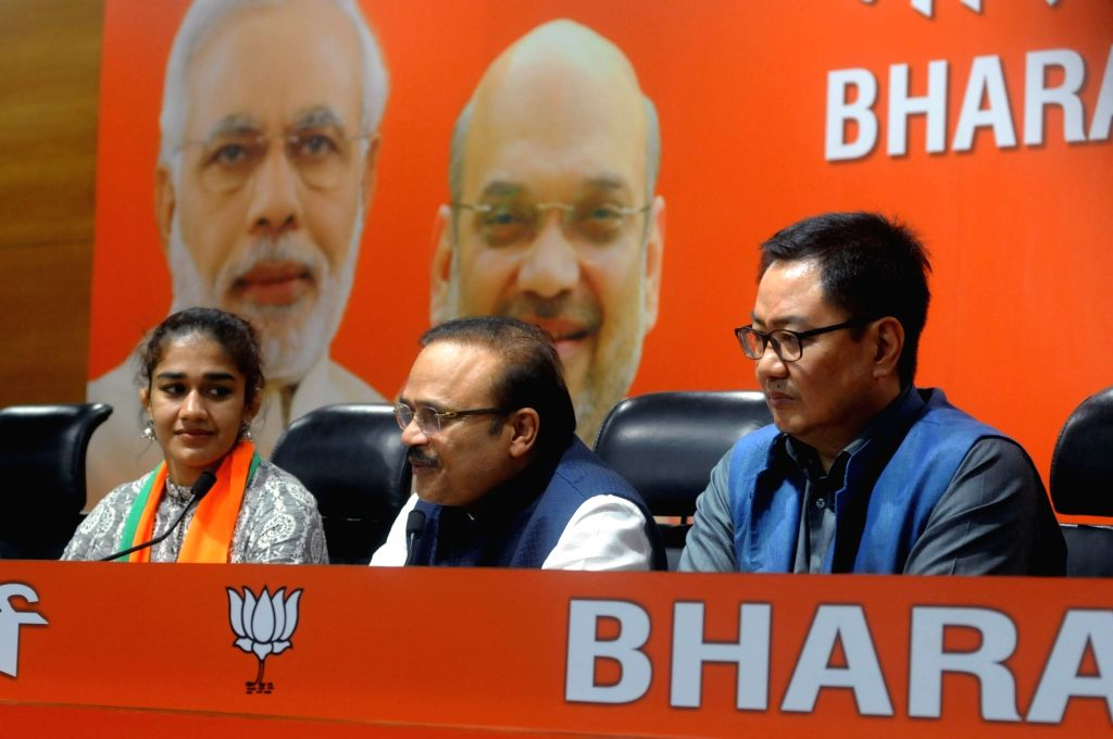Union Sports and Youth Affairs Minister and BJP leader Kiren Rijiju and party's general secretary in-charge of Haryana Anil Jain talks to press in New Delhi on Aug 12, 2019. Also seen ... - Haryana Anil Jain