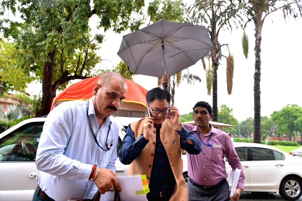 Union Sports Minister Kiren Rijiju arrives at Parliament in New Delhi on July 18, 2019. - Kiren Rijiju