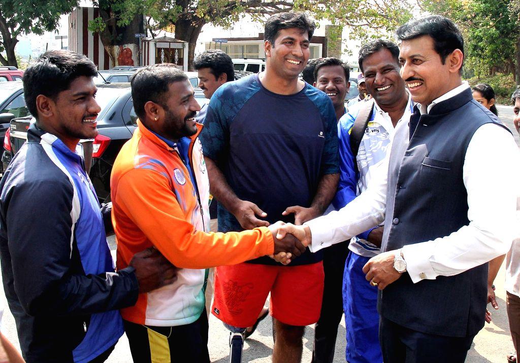 Union Sports Minister Rajyavardhan Singh Rathore inspects Sports Authority of India (SAI) campus in Bengaluru on March 22, 2018. - Rajyavardhan Singh Rathore