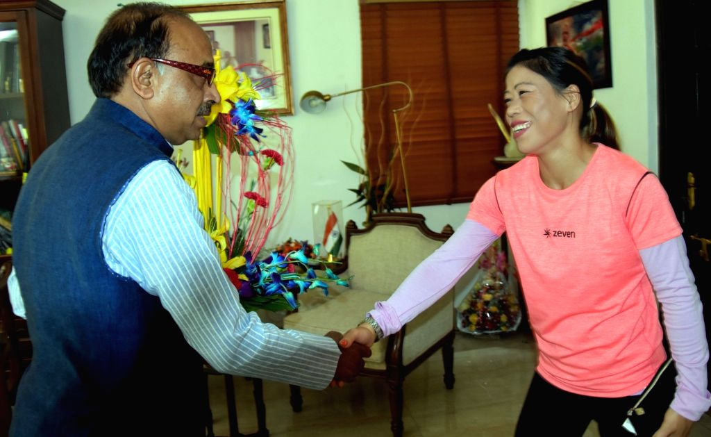 """Union Sports Minister Vijay Goel and boxer Mary Kom at the inauguration of """"Wall Of Wishes"""" & """"Digital Campaign of Wishes"""" for Indian Olympic Contingent in New ... - Vijay Goel and Mary Kom"""