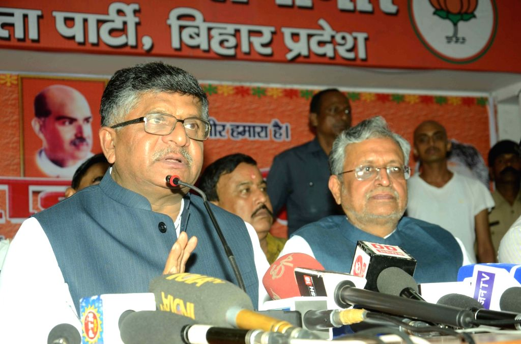 Union Telecom Minister and BJP leader Ravi Shankar Prasad addresses a press conference in Patna, on June 23, 2016. Also seen party leader Sushil Kumar Modi. - Sushil Kumar Modi