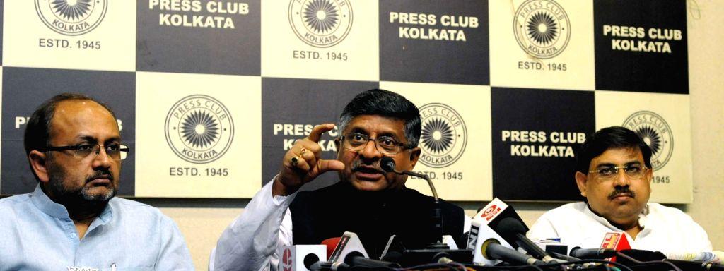 Union Telecom Minister Ravi Shankar Prasad addresses a press conference in Kolkata, on April 19, 2016. - Ravi Shankar Prasad