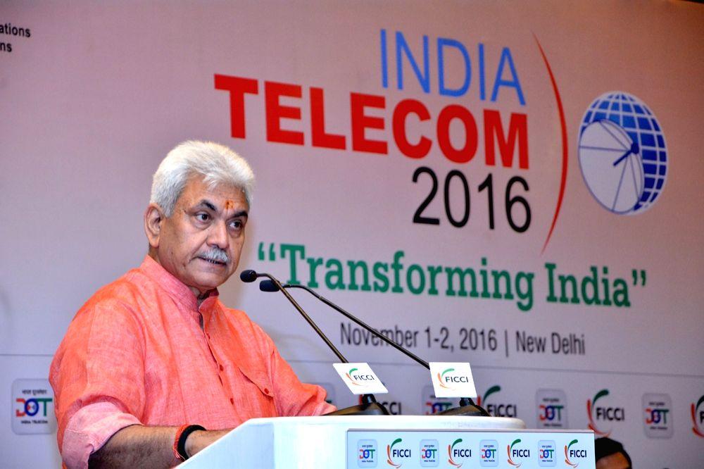 "Union Telecom MoS Manoj Sinha addresses during a India TELECOM 2016 conference on ""Transforming India"" in New Delhi on Nov 1, 2016. - Manoj Sinha"