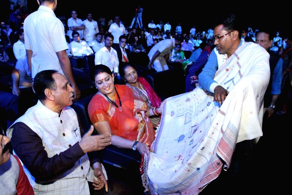 Union Textile Minister Smriti Irani, Gujarat Chief Minister Vijay Rupani at the India Handloom Brand fashion show on second day of the Textiles India 2017 at Mahatma Mandir in ... - Smriti Irani