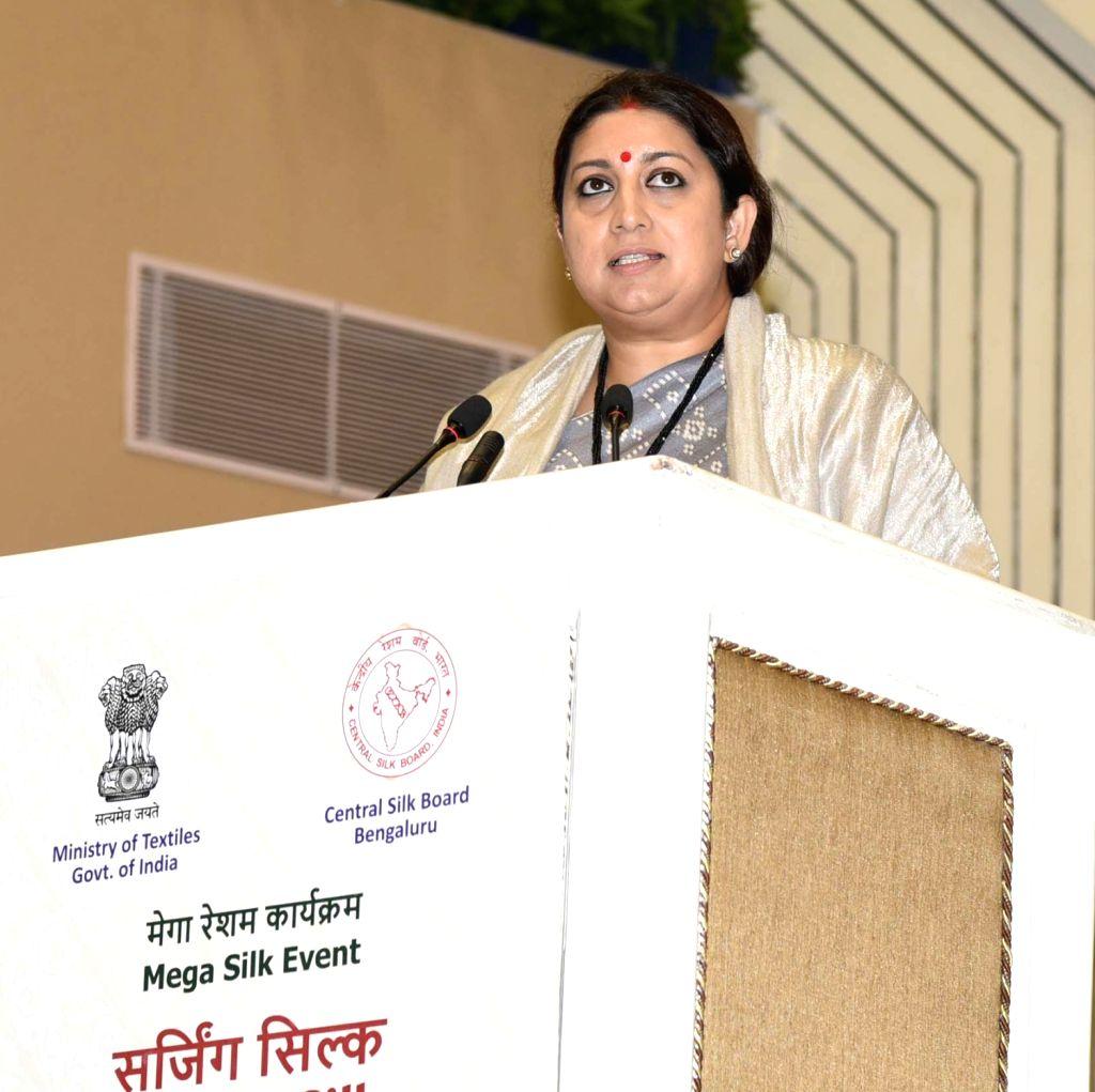 Union Textiles Minister Smriti Irani addresses at a Mega Silk event - Surging Silk, Accomplishment and way forward, in New Delhi on Feb 9, 2019. - Smriti Irani