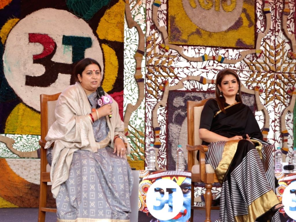 Union Textiles Minister Smriti Irani and actress Raveena Tandon at the Arth event in New Delhi on Feb 9, 2019. - Smriti Irani and Raveena Tandon