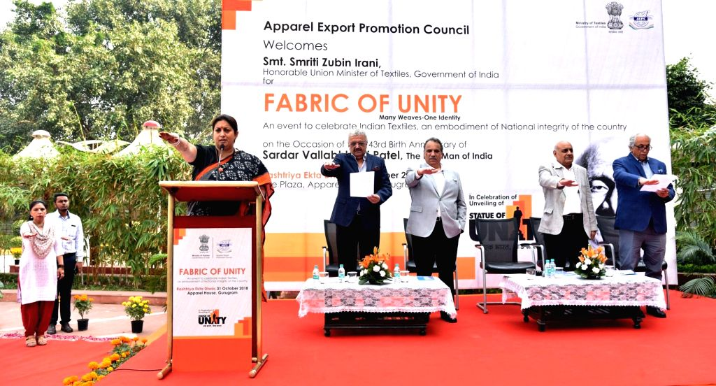 Union Textiles Minister Smriti Irani flags off 'March for Unity' organised on birth anniversary of the country's first Home Minister Sardar Vallabhbhai Patel in Gurugram on Oct 31, 2018. - Smriti Irani and Sardar Vallabhbhai Patel