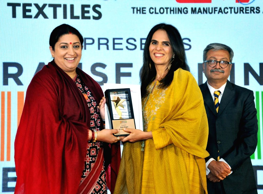 Union Textiles Minister Smriti Irani presents the 'Transforming India through Retail' Award to fashion designer Anita Dongre at an award ceremony organised by Clothing Manufacturers ... - Smriti Irani
