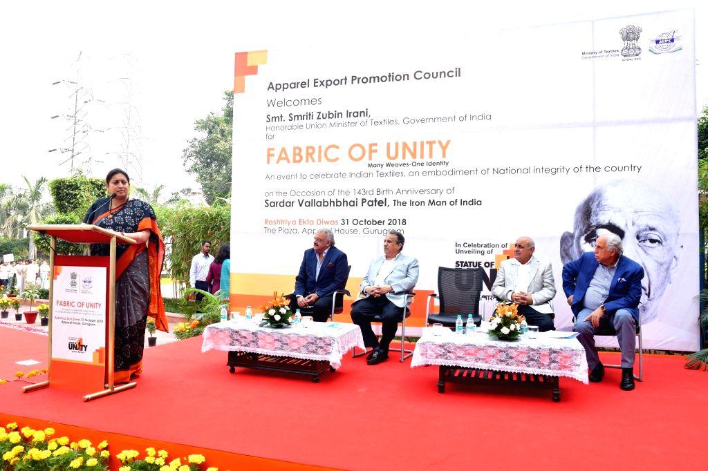 "Union Textiles Minister Smriti Irani  unveils ""Fabric of Unity""  at Apparel House, Gurugram as part of AEPC Unity Day celebrations on Oct 31, 2018. - Smriti Irani"
