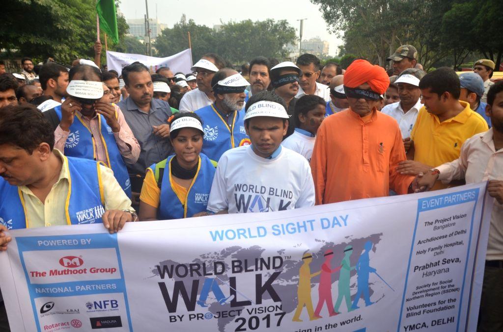 "Union Tourism Minister Alphons Kannanthanam and Delhi BJP chief Manoj Tiwari during the ""Blind Walk-2017"" programme in New Delhi on Oct 12, 2017. - Alphons Kannanthanam"