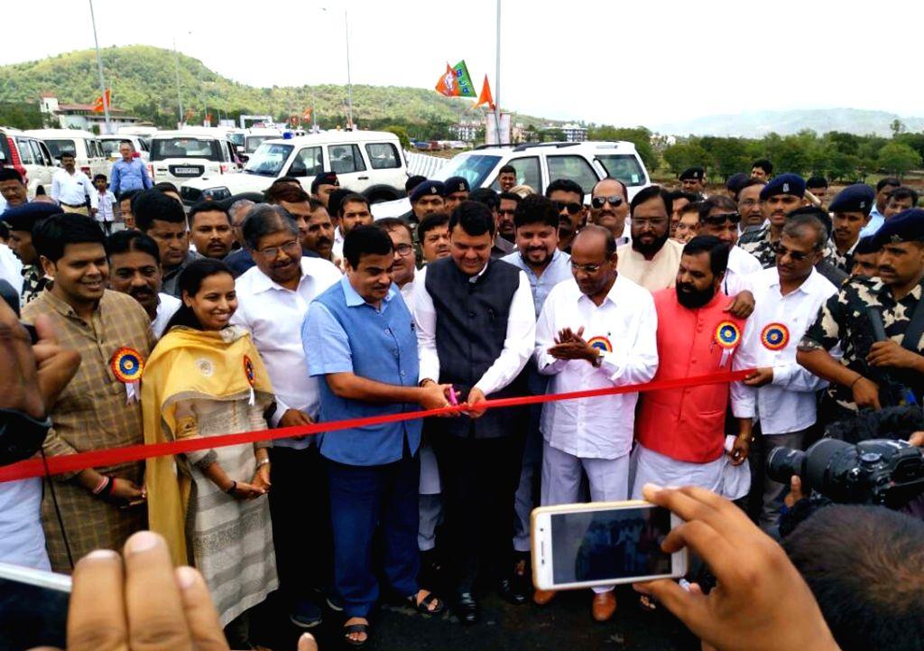 Union Transport Minister Nitin Gadkari and Maharashtra Chief Minister Devendra Fadnavis inaugurate the bridge across Savitri river, near Mahad that was built as an old masonry arch bridge ... - Nitin Gadkari