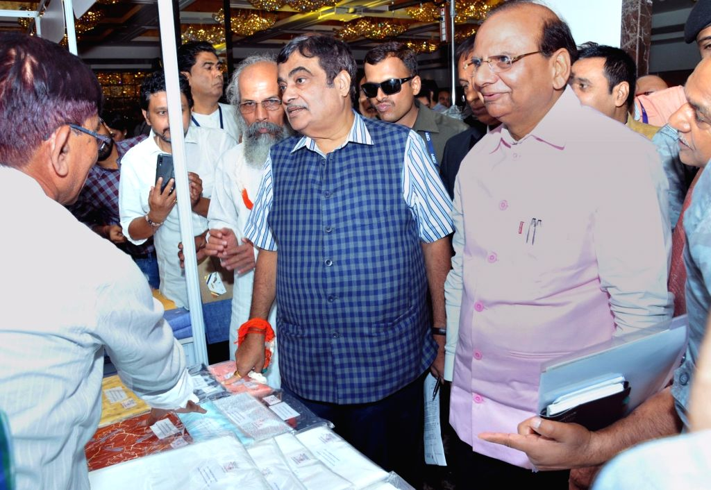 Union Transport Minister Nitin Gadkari and Union MSME Minister Pratap Chandra Sarangi visit an exhibition at the Business Summit for Globalizing the Brand - KHADI ???The Pride of India???, in ... - Nitin Gadkari