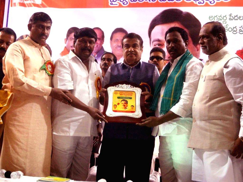 Union Transport Minister Nitin Gadkari with BJP leaders K. Laxman and Muralidhar Rao during a programme in Hyderabad, on Feb 5, 2019. - Nitin Gadkari and Muralidhar Rao