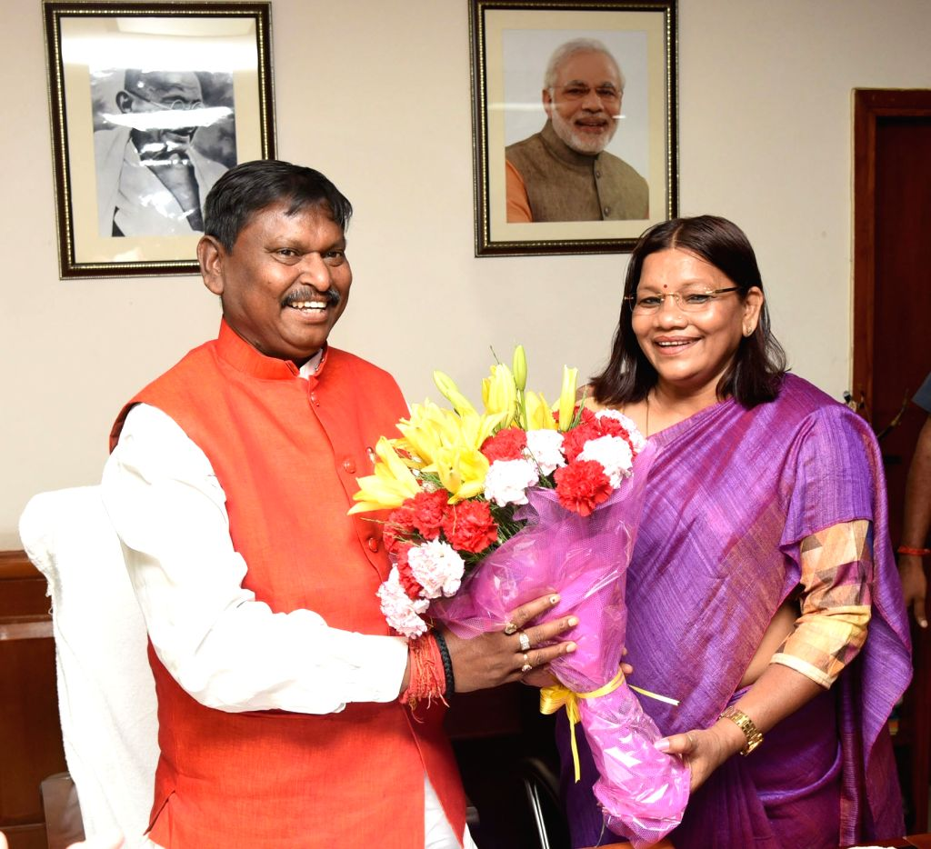 Union Tribal Affairs Minister Arjun Munda being greeted by MoS Tribal Affairs Renuka Singh Saruta after taking charge of office, in New Delhi on June 3, 2019. - Arjun Munda