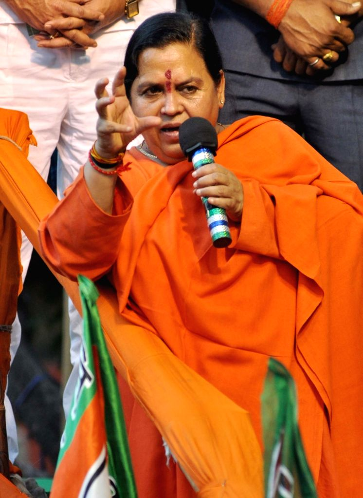 Union Water Minister Uma Bharati addresses during an election campaign ahead of the third phase of West Bengal assembly polls in Kolkata, on April 13, 2016. - Uma Bharati