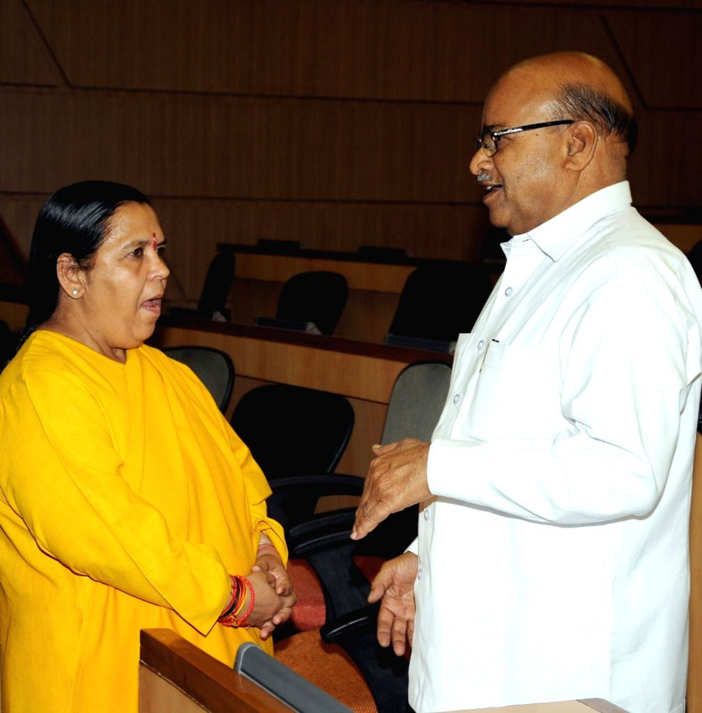 "Union Water Minister Uma Bharti and Union Minister for Social Justice and Empowerment Thawar Chand Gehlot at a National Seminar on ""Dr. Bhimrao Ambedkar – Multipurpose Development ... - Uma Bharti"