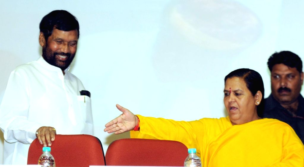 "Union Water Minister Uma Bharti and Union Food Minister Ram Vilas Paswan at a National Seminar on ""Dr. Bhimrao Ambedkar – Multipurpose Development of Water Resources and Present ... - Uma Bharti"