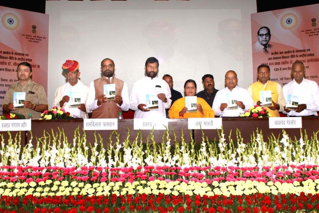 "Union Water Minister Uma Bharti and Union Food Minister Ram Vilas Paswan and Union Minister for Social Justice and Empowerment Thawar Chand Gehlot at a national seminar on ""Dr. ... - Uma Bharti"