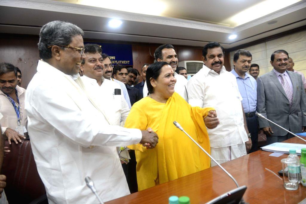Union Water Resources Minister Uma Bharti with Karnataka Chief Minister Siddaramaiah and Tamil Nadu Minister Edappadi K Palanisamy during a meeting regarding Cauvery water sharing issue in ... - Uma Bharti