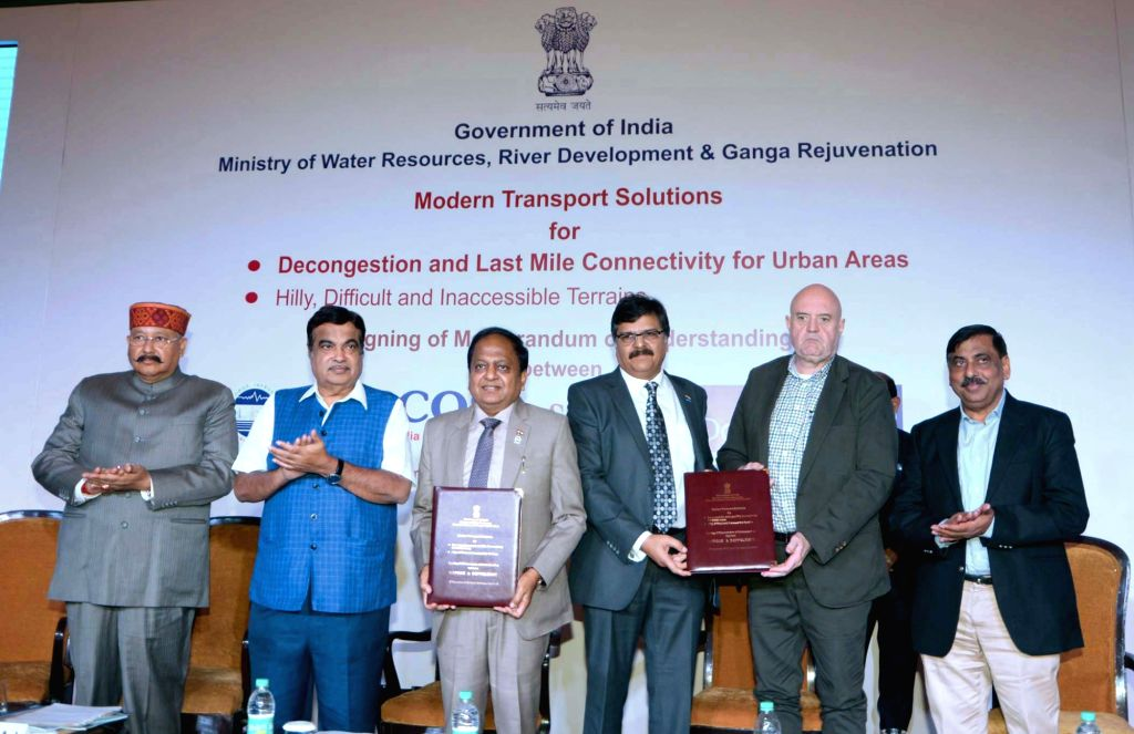 Union Water Resources, River Development and Ganga Rejuvenation Minister Nitin Gadkari witnesses the signing ceremony of an MoU between WAPCOS Limited and Doppelmayr, Austria for Modern ... - Nitin Gadkari and P. Singh