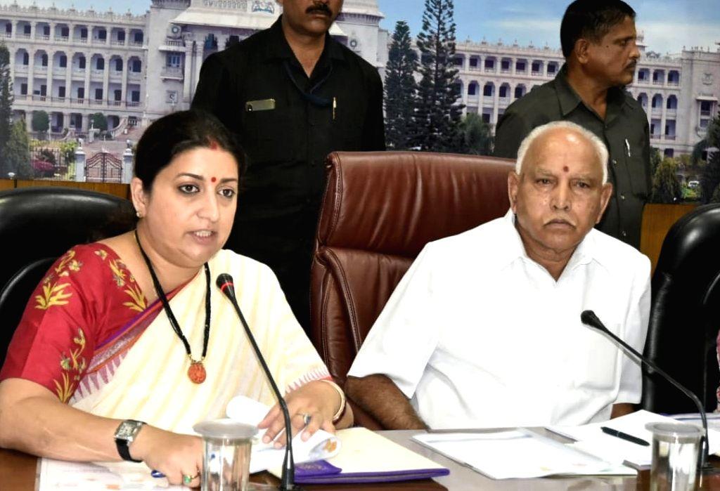 Union Women and Child Development and Textiles Minister Smriti Irani accompanied by Karnataka Chief Minister B. S. Yediyurappa, addresses during a meeting in Bengaluru on Sep 13, 2019. - Smriti Irani