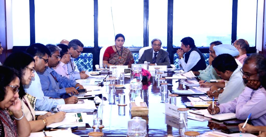 Union Women and Child Development and Textiles Minister Smriti Irani and 15th Finance Commission Chairman N.K. Singh during a meeting in New Delhi on Sep 14, 2019. - Smriti Irani and K. Singh