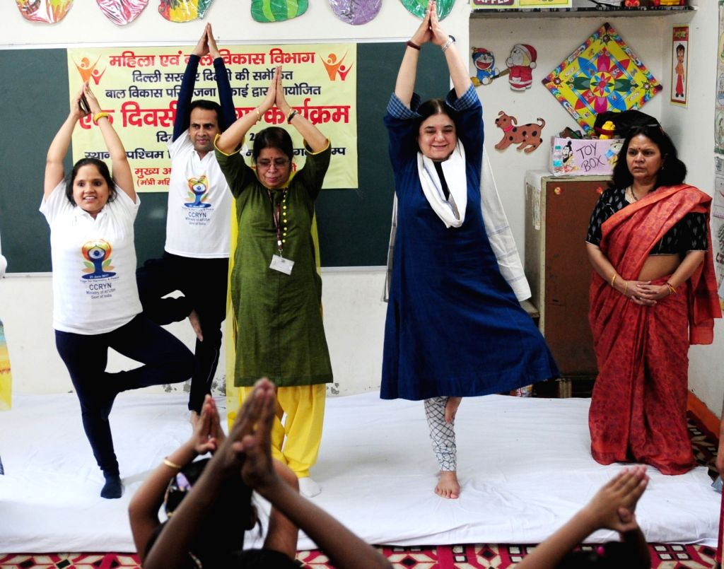 Union Women and Child Development Minister Maneka Sanjay Gandhi participates in Yoga session with Anganwadi Children in New Delhi on June 18, 2017. - Maneka Sanjay Gandhi
