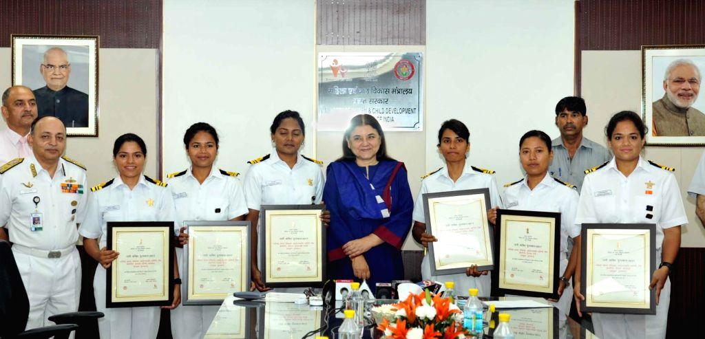 Union Women and Child Development Minister Maneka Sanjay Gandhi with the crew members of INSV Tarini that was a part of the Indian Navy's unique project 'Navika Sagar Parikrama', ... - Maneka Sanjay Gandhi