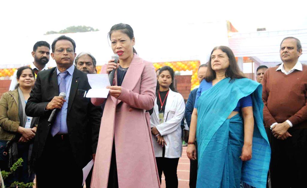 Union Women and Child Development Minister Maneka Gandhi unfurls the National Flag and inaugurates HAUSLA 2018 Sports Meet open, at Jawaharlal Nehru Stadium in New Delhi, on Nov 28, 2018. ... - Maneka Gandhi and Mary Kom