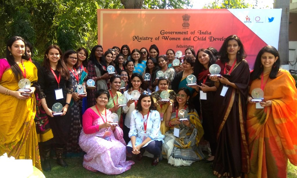 Union Women and Child Development Minister Maneka Sanjay Gandhi with the winners of the 'Web Wonder Women' contest, in New Delhi, on March 6, 2019. - Maneka Sanjay Gandhi