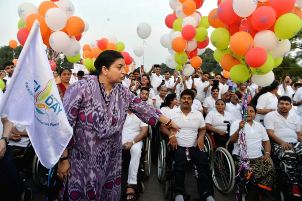 Union Women and Child Development Minister Smriti Irani flags off 'Wheelchair Rally' organised on the occasion of World Spinal Injury Day at India Gate in New Delhi on Sep 8, 2019. - Smriti Irani