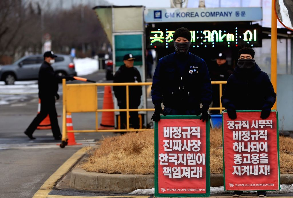 Unionized workers of GM Korea Co., the South Korean unit of General Motors, rally in front of a gate to its plant in the western port city of Gunsan on Feb. 14, 2018, to voice their objection ...