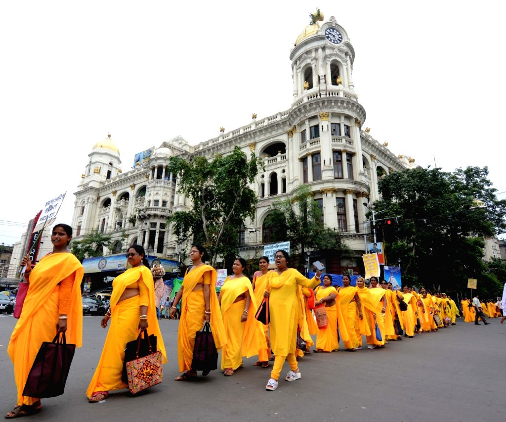 United Auxiliary Nurses participate in a protest march against the West Bengal Government, in Kolkata on July 26, 2019.