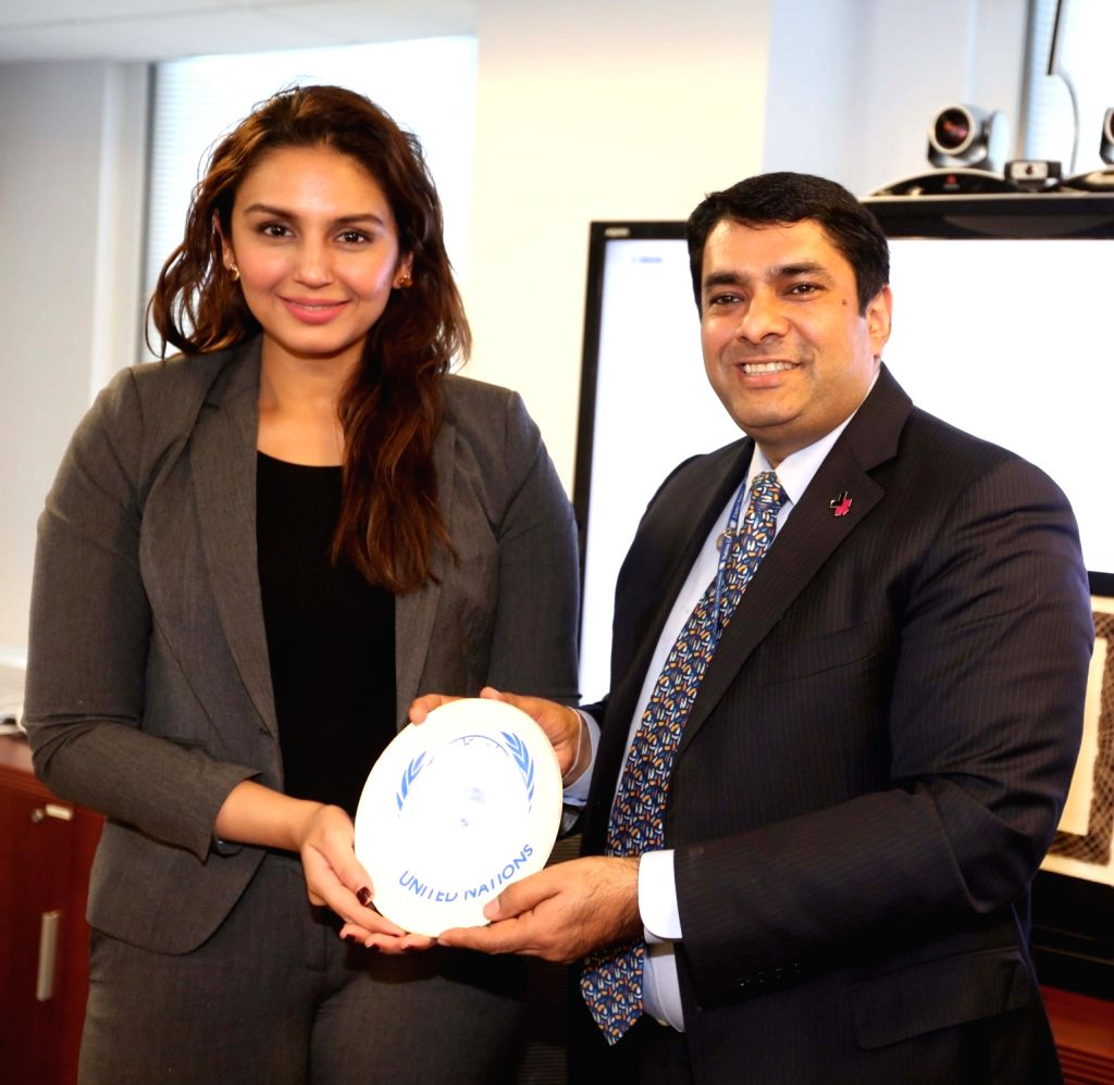 United Nations: Actress Huma Qureshi being honoured by Senior Advisor to the Deputy Executive Director, UN Women Ravi Karkara at United Nations Headquarters where she talked about on ... - Huma Qureshi