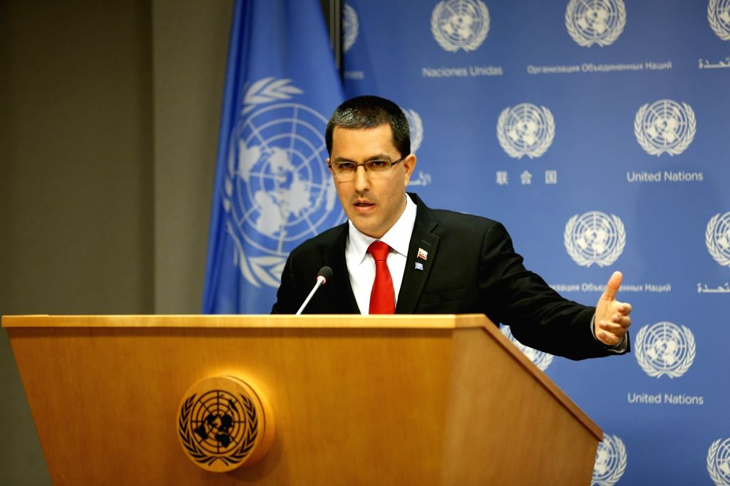 "UNITED NATIONS, April 25, 2019 - Venezuelan Foreign Minister Jorge Arreaza holds up a Spanish copy of the ""Charter of the United Nations"" as he speaks at a press conference at the United ... - Jorge Arreaza"