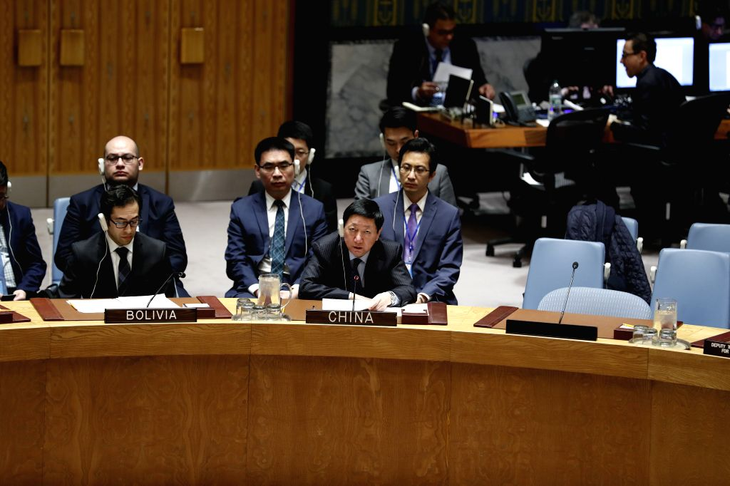 UNITED NATIONS, April 4, 2018 - China's Deputy Permanent Representative to the United Nations Wu Haitao (R, Front) addresses a UN Security Council meeting on the situation in Syria at the UN ...