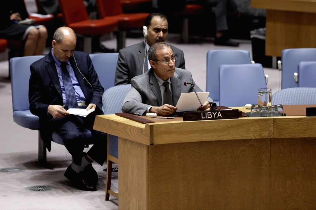UNITED NATIONS, Aug. 10, 2019 - Elmahdi S. Elmajerbi (front), Charge d'affaires of Libya to the United Nations, addresses a Security Council emergency meeting on the situation in Libya at the UN ...