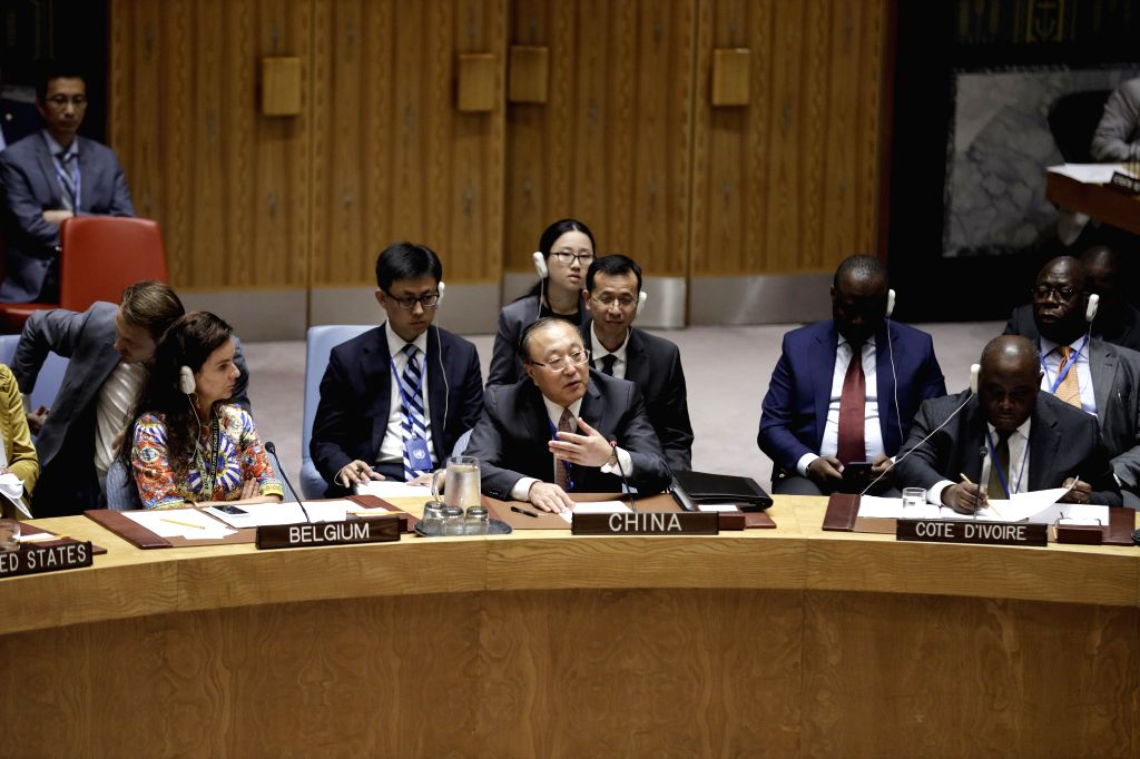 UNITED NATIONS, Aug. 2, 2019 - Zhang Jun (C, front), Chinese Permanent Representative to the United Nations, addresses a Security Council meeting on Children and armed conflict, at the UN ...