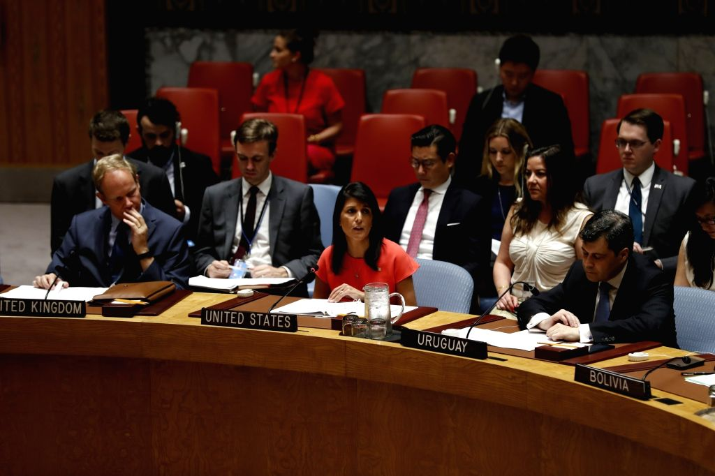 UNITED NATIONS, Aug. 6, 2017 - Nikki Haley (C, front), U.S. Permanent Representative to the United Nations, addresses after the UN Security Council adopted a resolution that aims to slash by a third ...