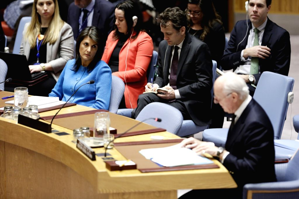 UNITED NATIONS, Feb. 14, 2018 - U.S. Ambassador to the United Nations Nikki Haley (L, Front) looks as the UN Special Envoy for Syria Staffan de Mistura (R, Front) addresses a UN Security Council ...