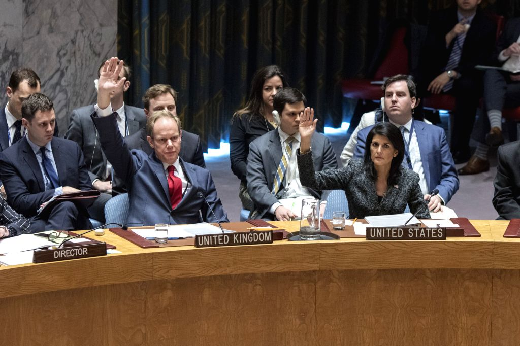 UNITED NATIONS, Feb. 28, 2017 - UK's permanent representative to the UN Matthew Rycroft (L, front) and U.S. ambassador to the UN Nikki Haley (R, front) vote in favor of a UN Security Council draft ...