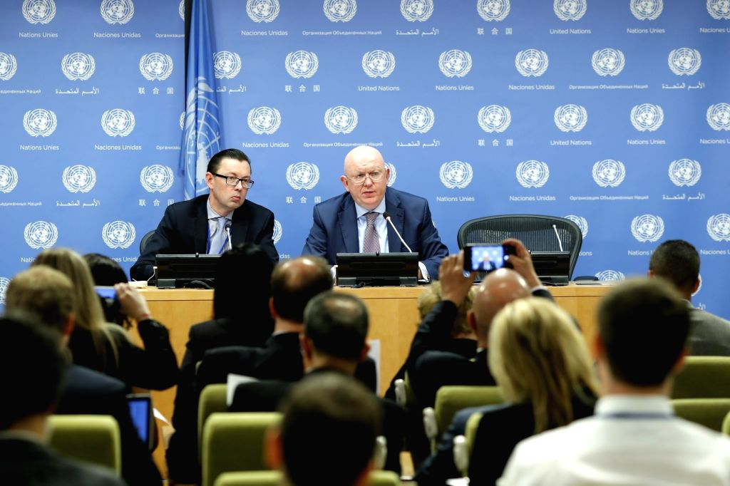 UNITED NATIONS, June 1, 2018 - Vassily Nebenzia (R, Rear), Russian Ambassador to the United Nations and President of the Security Council for the month of June, speaks during a press conference at ...