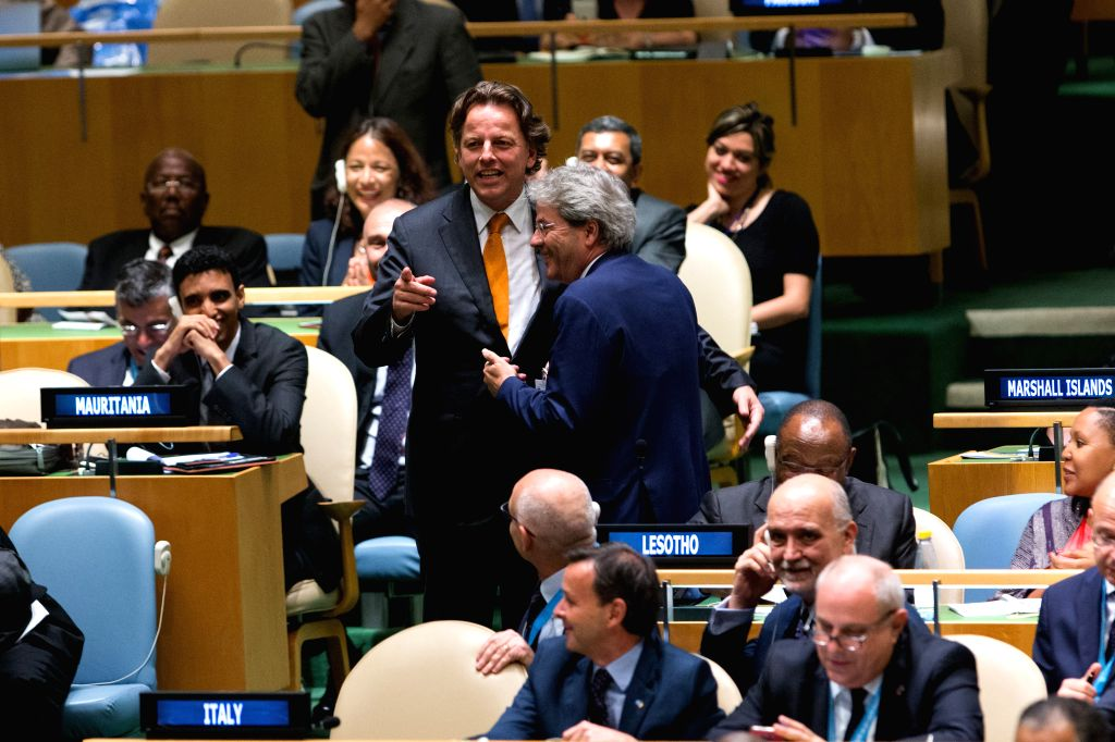 UNITED NATIONS, June 28, 2016 - Bert Koenders(L, center), foreign minister of Netherlands, speaks with Italian foreign minister Paolo Gentiloni(R, center), during the election of non-permanent ... - Paolo Gentiloni